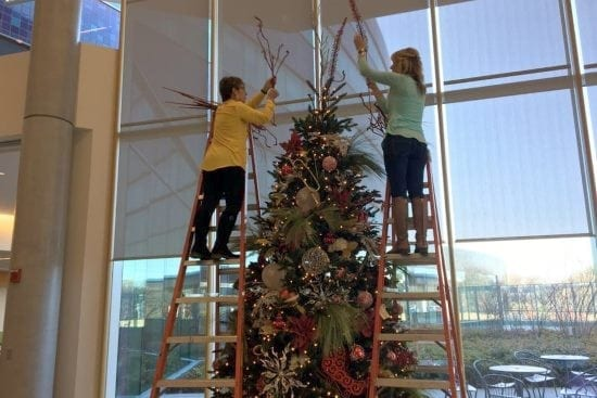 Custom Christmas tree decorating for Cincinnati businesses by Sacksteders Interiors.