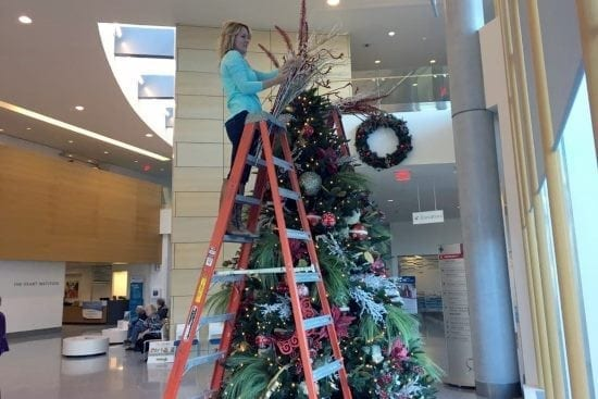 The Sacksteder Interiors team decorating a Cincinnati business for the holiday.